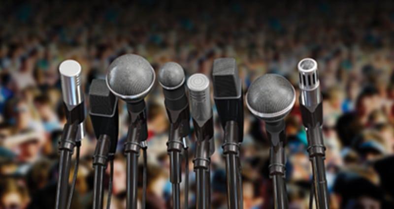 Microphones on a podium