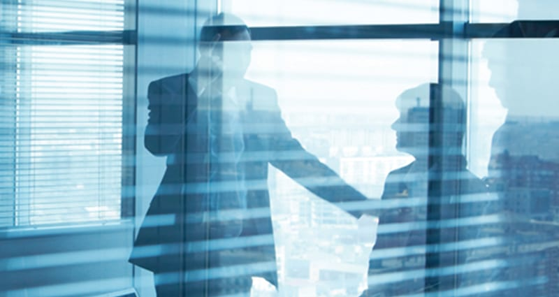 Business meeting in glass conference room