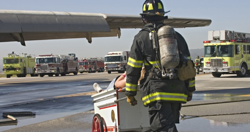 Fire fighter headed to help on runway