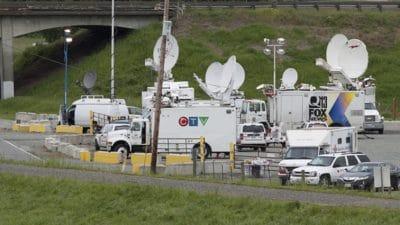Media trucks lined up outside