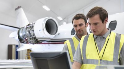 Two technicians working on plane