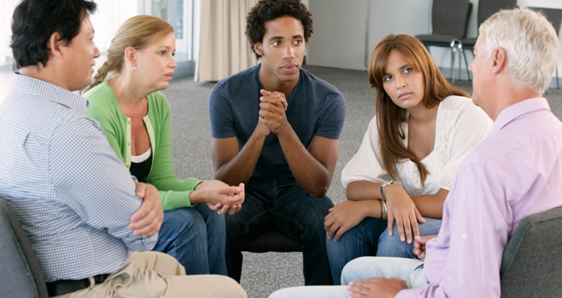 Group of five people intimately talking