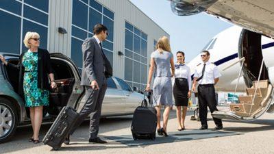 Group meeting pilots before boarding plane