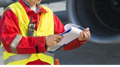 Man with safety vest and clipboard