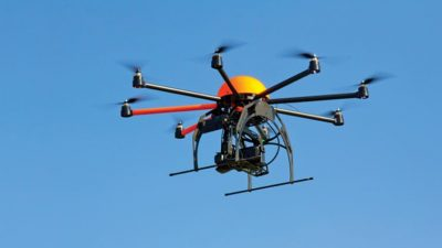Large drone flying in cloudless sky