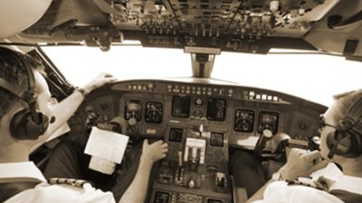 Two pilots sitting in cockpit