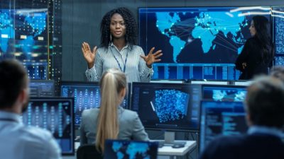 Woman addressing cyber concerns to coworkers