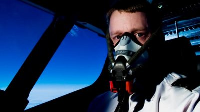 Pilot flying while wearing oxygen mask