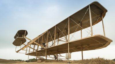 Large wooden biplane on beach