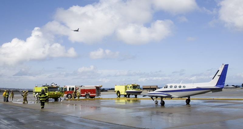 Emergency crews tending to aircraft on runway