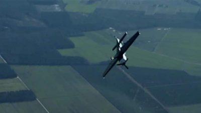 Prop plane doing a barrel roll