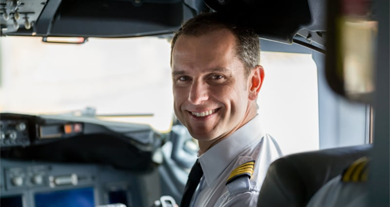 Pilot turned around smiling from cockpit