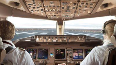 Man and woman pilot taxiing