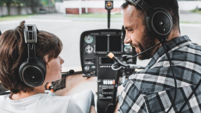 Older pilot teaching younger pilot