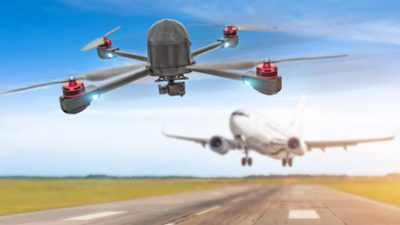 Drone flying in front of airplane