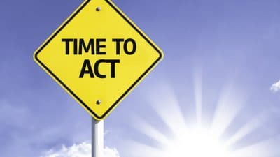 time to act sign